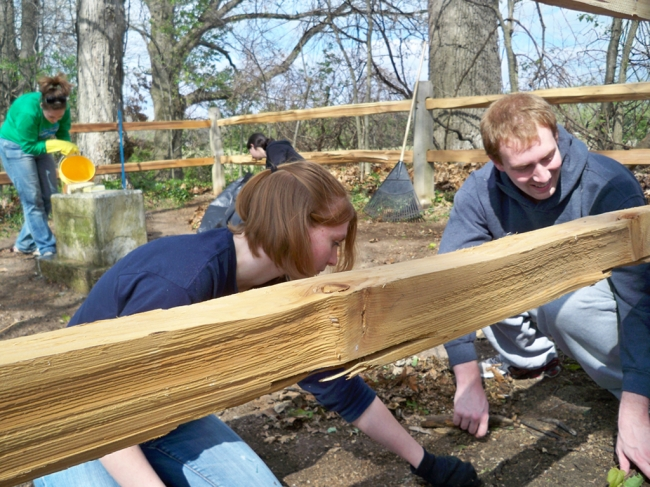 Students install new fence around the grave of Adrian-area abolitionist, Elizabeth Chandler. This project was part of the