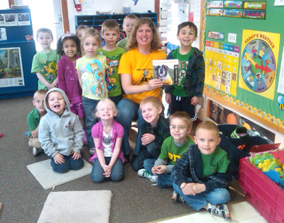 Dr. Milner read Bruiser goes to College to the Blissfield Preschool Cooperative Nursery, Inc.